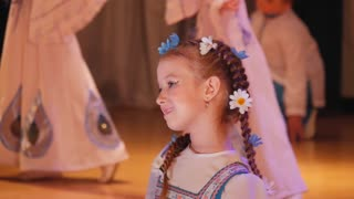Pretty little girl dances on stage, performance of artists.