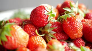 Red ripe organic strawberries on market counter. Strawberry background.