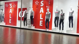 Red sign on a shop window. Sale in a clothing store