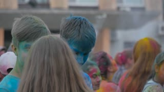 RUSSIA, URYUPINSK - JUNE 29, 2018: Crowd of people colored powder and having fun. Color powder relaxing at outdoor party together, youth spirit, fun in Holi festival atmosphere.