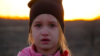 Sad girl crying during sunset on nature closeup