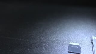 SD card and micro SD Card Adapter on black background.