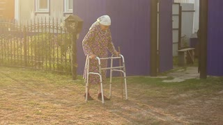 Senior woman using a walker. An elderly senior adult using a walker to help her mobility.