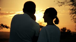 Silhouette, happy child with mother and father, family at sunset, summertime. We are happy family. The concept of the family.