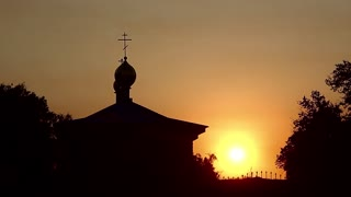 Silhouette of the church building at sunset