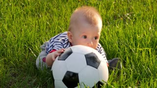 Small boy playing with soccer ball.