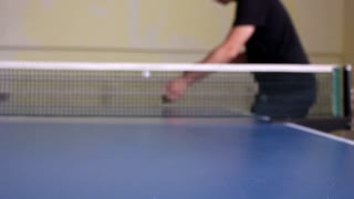 table tennis player serving, closeup - small depth of field, focus at the ball!