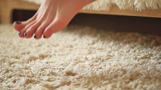 The legs on the beige carpet