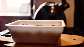 The process of preparing instant noodles with spices, vegetables, and meat. Slow motion of pouring boiling water into the instant noodles, stirs instant noodles with a fork.