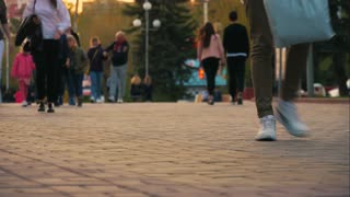 Timelapse crowds of people walking on city pavement tiles. The footsteps of a crowd of people go on business in the metropolis. People Walking on Sidewalk. Legs. Fast Motion. 4K