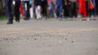Timelapse crowds of people walking on city pavement tiles. The footsteps of a crowd of people go on business in the metropolis. People Walking on Sidewalk. Legs.