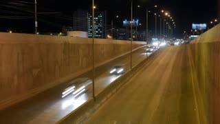 Timelapse of night traffic in highway at city.