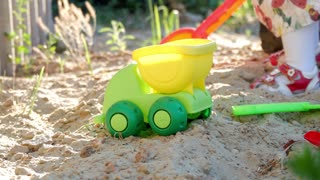 Toy car on the sand for child games.