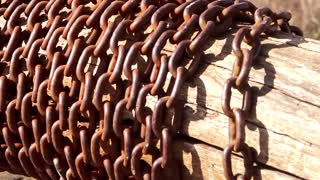 Vintage water well chain close up. Old rusty chain of the village well.