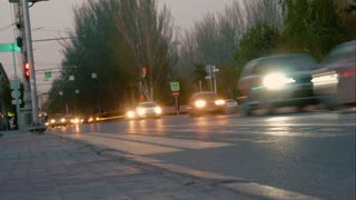 VOLGOGRAD. RUSSIA - MAY 13, 2018: Timelapse crowds of people walking on city pavement tiles. The footsteps of a crowd of people and car go on business in the metropolis.