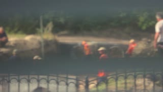 Workers on the construction site. Construction of the road. Soft focus.
