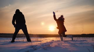 Young father and his daughter having fun on winter sunset