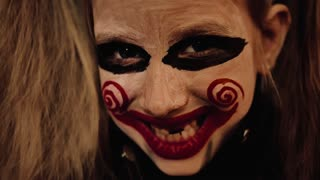 Young girl with film cosplay makeup. Girl with make-up in nightmare style a black background.