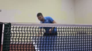 Young sports man tennis-player in play on old gym. Action shot.