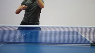 Young table tennis player in play. Action shot.