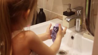 Young girl rag underwater water bath