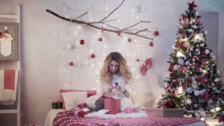 Attractive brunette wraps Christmas gifts