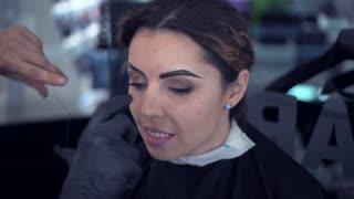 Master does makeup-depilation to a beautiful girl. Brow bar