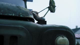 Old abandoned desolate military retro truck and near children's bear toy. Chernobyl