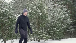 The girl jumps on the back of the man and they run together. Winter. Slow mo