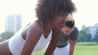 African American woman on a running stretching her neck. Pain during the training.
