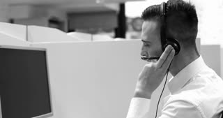 black and white video of Call Center Operator Providing The Client With All The Necessary Information