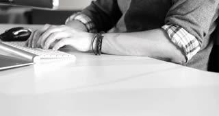 black and white video of software developer working on desktop computer