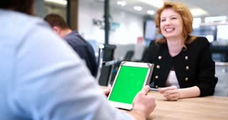 Business People Working With Digital Tablet In Office. Green screen tablet