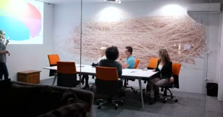 business, technology, management and people concept - smiling female boss talking to business team in office