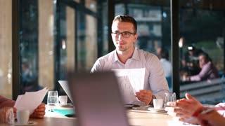 Businessman Presenting data To Business Team