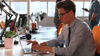 Businessman with glasses Working In startup Office On Desktop Computer