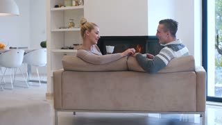 Caucasian Couple Drinking Coffee At Home