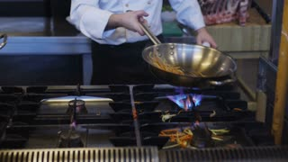 Chef Cooking In Wok Pan