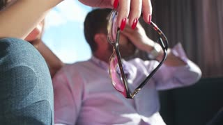 close up of woman  Holding A Glasses with man in background
