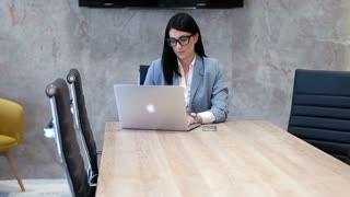 Corporate Professional Woman Using Laptop In Office Conference Room