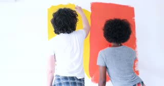 couple having fun while painting house