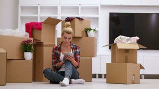 couple moving in new aprtment and using tablet to organise home