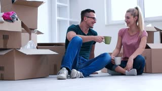 couple relaxing after moving in new apartment