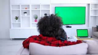 Couple Watching Green Screen Television And using other green screen devices