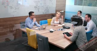 Creative Design Team Collaborating On A Project In Modern Office