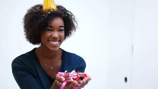 Cute Afro American Woman  Blowing Confetti Over white backgorund