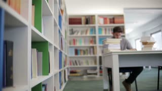 famale student reading book in library