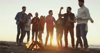 Friends Dancing At Bonfire Beach Party