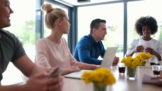 Group Of Business People Meeting Around Table in startup office