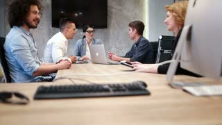 Group Of Casual Business People Discussing During Business Meeting